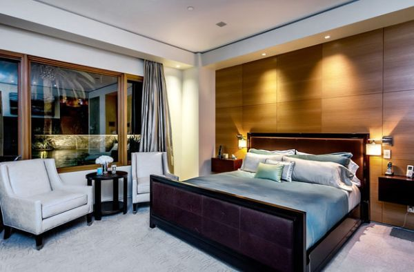 Sconce lights combine beautifully with the recessed lighting in the bedroom