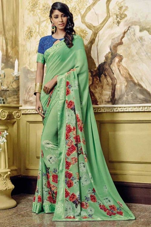 Green Georgette Saree with blue georgette Blouse Online  http://www.andaazfashion.co.uk/womens/sarees