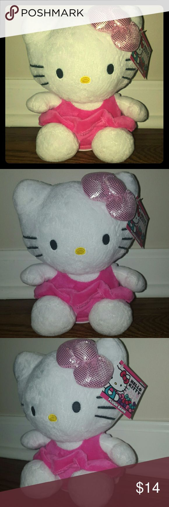 Hello Kitty Plush Piggy Bank Hello Kitty Plush Stuffed Animal Piggy Bank. Extremely soft! Coin hole insert. Stands up straight. New with tags! Hello Kitty Other