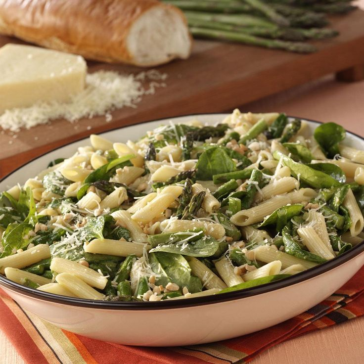 Asparagus-Spinach Pasta Salad Recipe -Fresh spinach, crunchy cashews and penne pasta are tossed with roasted asparagus to create this delightful spring salad. —Kathleen Lucas, Trumbull, Connecticut