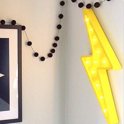 Thunderstruck with a kid friendly, battery operated thunderbolt. Source from http://littleletterlights.com