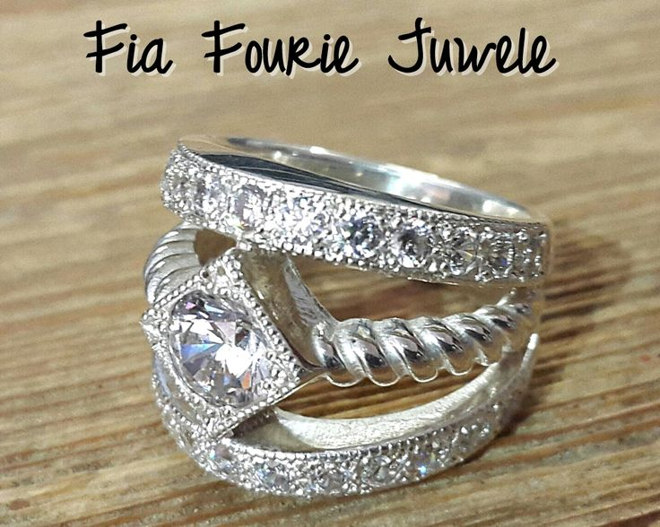 Love love love this design!!!! Chunky ring, shiny sterling silver with cubic zirconia gemstones