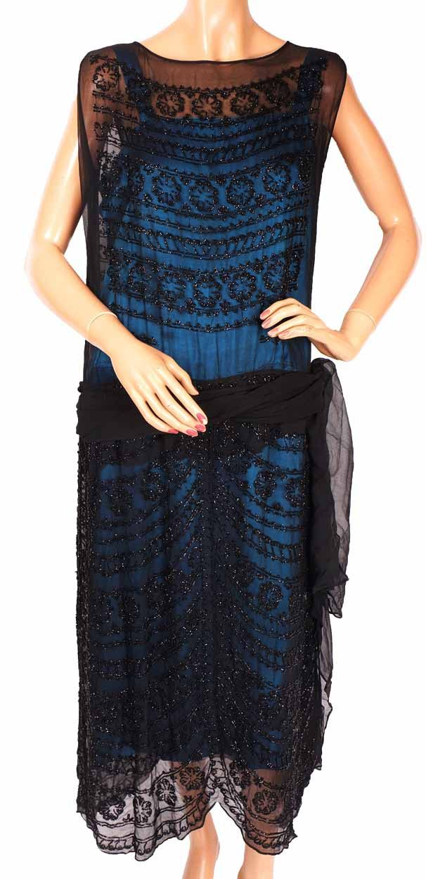 Age: 1920s Label: None Color: Black Material: Beads on silk chiffon Sizing: No size is indicated, but this should fit a medium size - please rely on the following exterior measurements for fit, taking