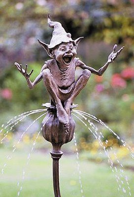 David Goode, sculpture, England, His work is going for 3k to 18k or so a piece.  Wouldn't this be a perfect piece of 'ice cream' for the garden ... goblin art ... he sits atop a poppy pod sprinkler.