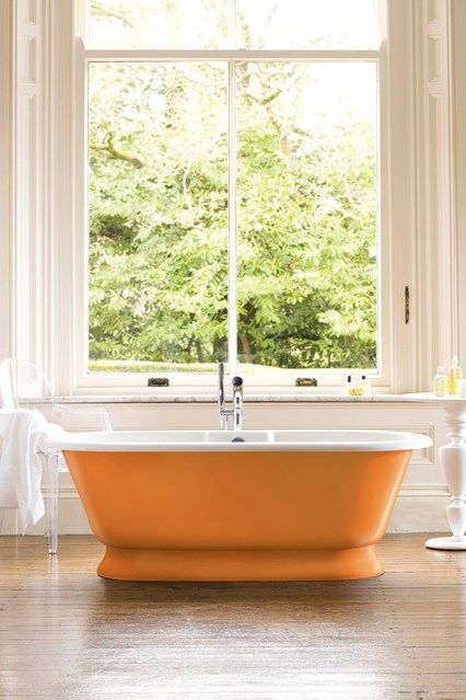 Add Some Orange - Bathroom Ideas - Tiles, Furniture & Accessories (houseandgarden.co.uk) Don't limit yourself to just painting walls. A freestanding bath can often be the main focus of the room so why not draw even more attention to it by painting it a vibrant colour? We love how this orange tub pops against the wooden floor and cream walls.