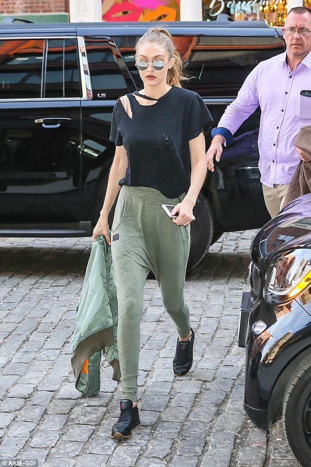 Get Gigi's look down to a T with her distressed black top #DailyMail Click 'Visit' to buy now