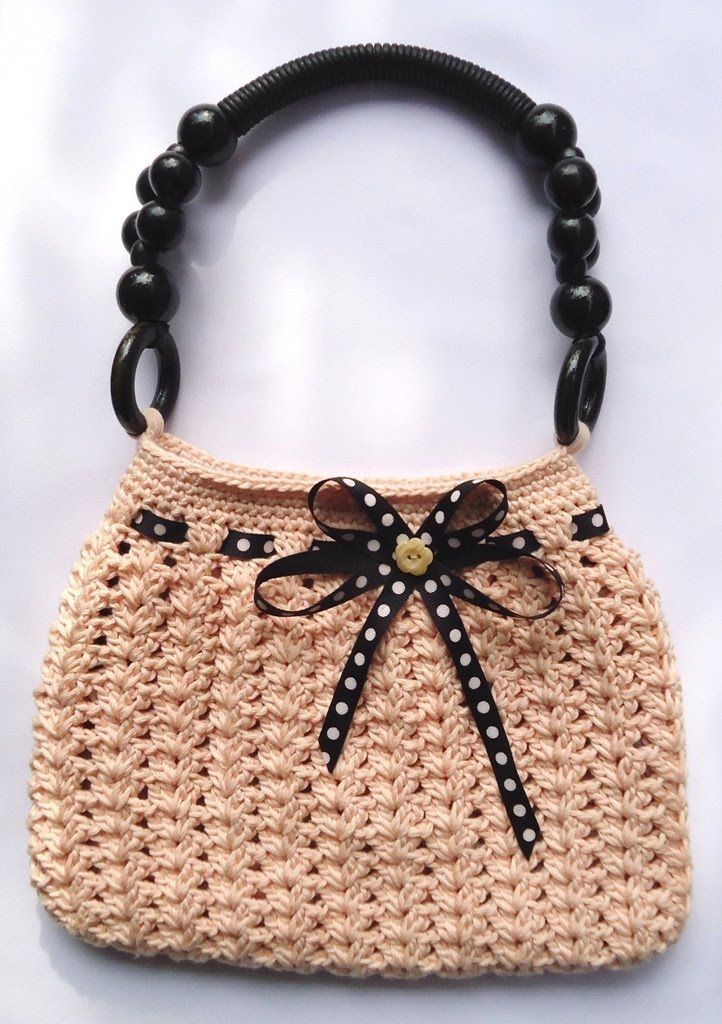 Why not crochet yourself or a friend a sweet little bag? Why not indeed.  Stitch of Love made this little lovely based on the pattern found here. This is going on my to-crochet list for sure!