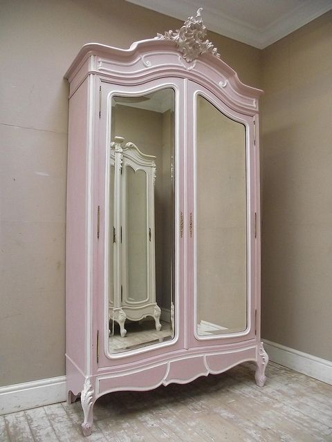 antique Rococo style French armoire repainted in gentle dusted pink with white highlights