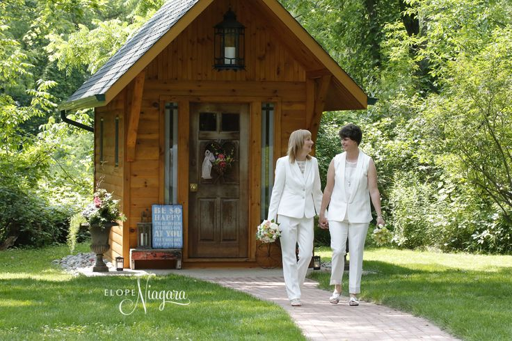 Hand In Hand At The Little Log Wedding Chapel