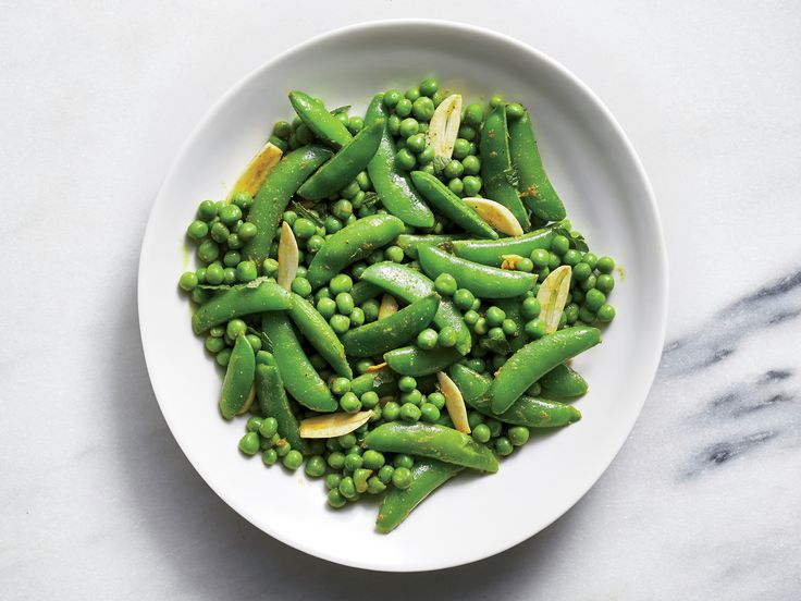 For a Versatile Side Dish, Make Curried Peas With Mint and Lime | Green peas are a freezer staple, making this side dish that much easier to come together. Serve this herby side with roast beef or lamb. Stir any leftover peas into an Indian-style curry on another night.