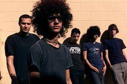 Спустя два месяца после релиза камбэк-сингла «Governed By Contagious» американская пост-хардкор группа из Эль-Пасо At The Drive In сообщила подробности своего нового альбома «in • ter a • li • a», первого за 17 лет. Альбом выйдет 5 мая на Rise Records. Группа также опубликовала лирик-видео н�
