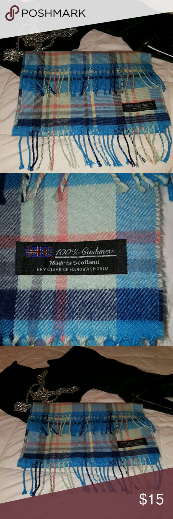 100% Cashmere Scarf, lovely hues of blue and pink A beautiful scarf. Blues, black, pink and cream colors. Made in Scotland. Great condition. Warm! Accessories Scarves & Wraps