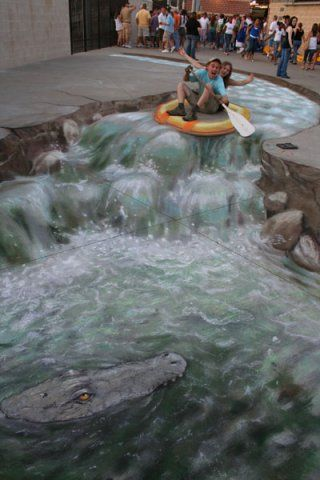 Julian Beever is a chalk artist that does these amazing 3-D illusions on city streets.  Check out his website and watch him create.