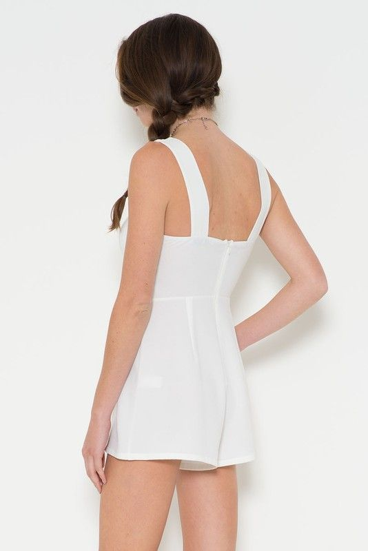 This woven crepe cutout romper makes you look sexy and beautiful. It is sleeveless. It has low back with wide straps. The cutout keyhole in front to reveal a small part of the bust to make it sexy. It is made of woven crepe material.