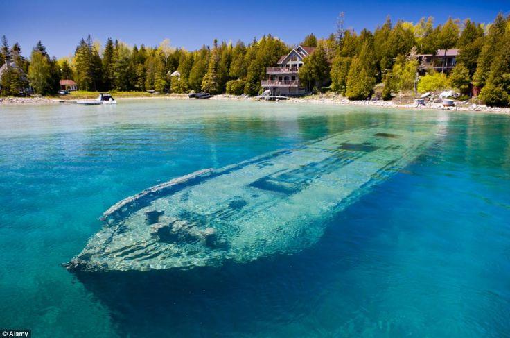 Haunting: The hull of Sweepstakes lies just twenty feet below clear blue water of Ontario lake where it sank in 1885