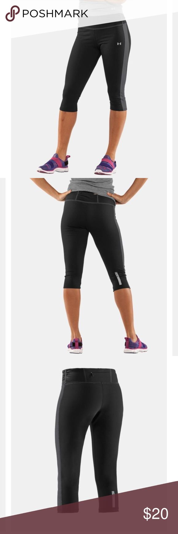 """Under Armour 16"""" Escape Capri Next-to-skin without the squeeze. Mid-weight AllSeasonGear® fabric delivers optimal comfort between the extremes Lightweight, 4-way stretch construction improves mobility and accelerates dry time Superior Moisture Transport System wicks away sweat so you stay dry and focused Wide waistband with feminine ruching detail offers an updated style and a smoother, more flattering fit 360° reflectivity enhances visibility  Rear zippered pocket  16"""" inseam hits just…"""