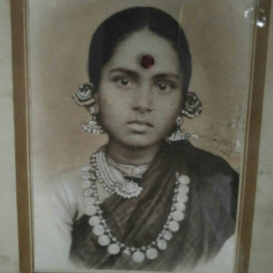 Vintage indian woman.  This my paternal grandmother, Parvathamma. She passed away very early, when my dad the fourth child was very young. She was a very brave woman who ran the business of the household. All the wealth vanished along with her. My grandfather in 1940's never married again and solely brought up his 4 children.