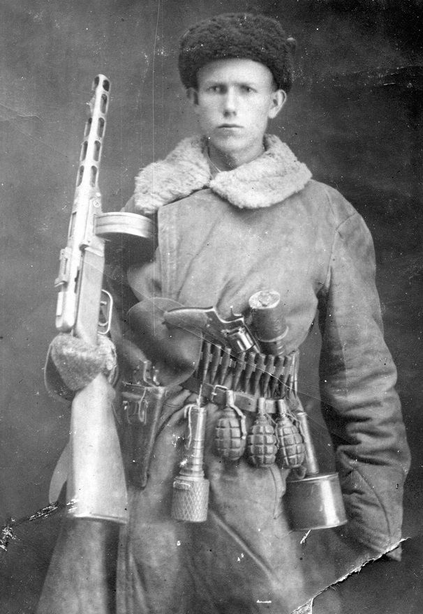 Russian soldier armed with PPSh-41, 1895 Nagant revolver and hand grenades