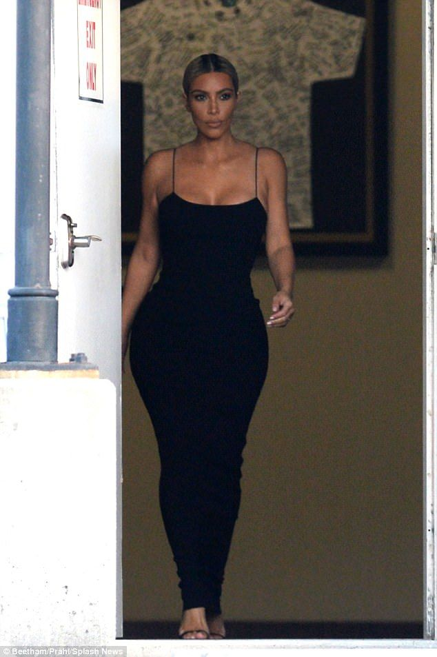 Never not entrancing: Kim Kardashian (above) exits the airport after touching down in New ...