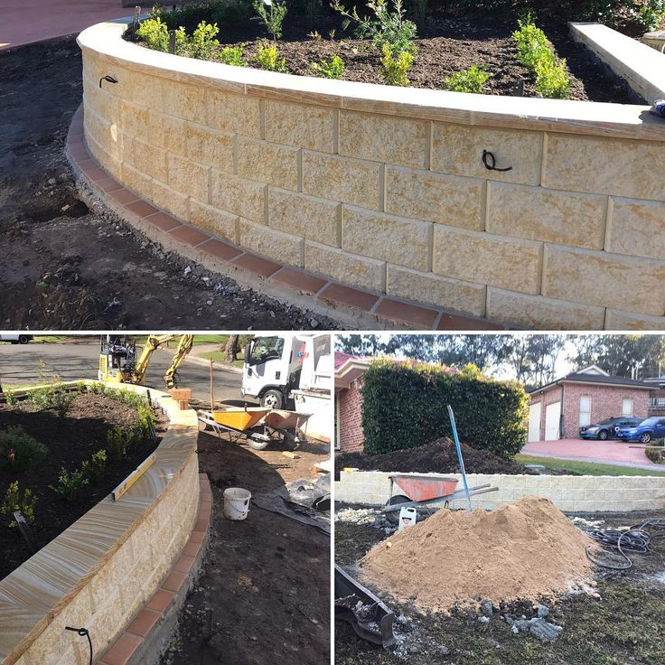 Amber Tiles Kellyville: Keystone blocks dressed up with sandstone capping by Macquarie Towns Landscaping