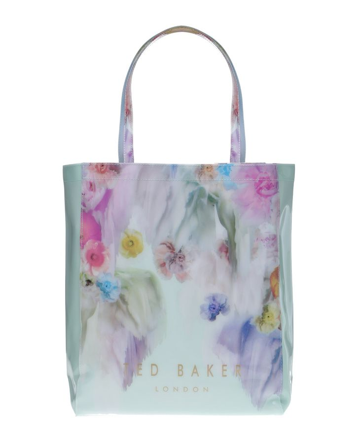 Give your essentials a stylish new home with the Sugarcon floral handbag from renowned British brand Ted Baker. Crafted from creamy mint PVC, this tote features an all-over floral design as well as Ted Baker's trademark brand logo.