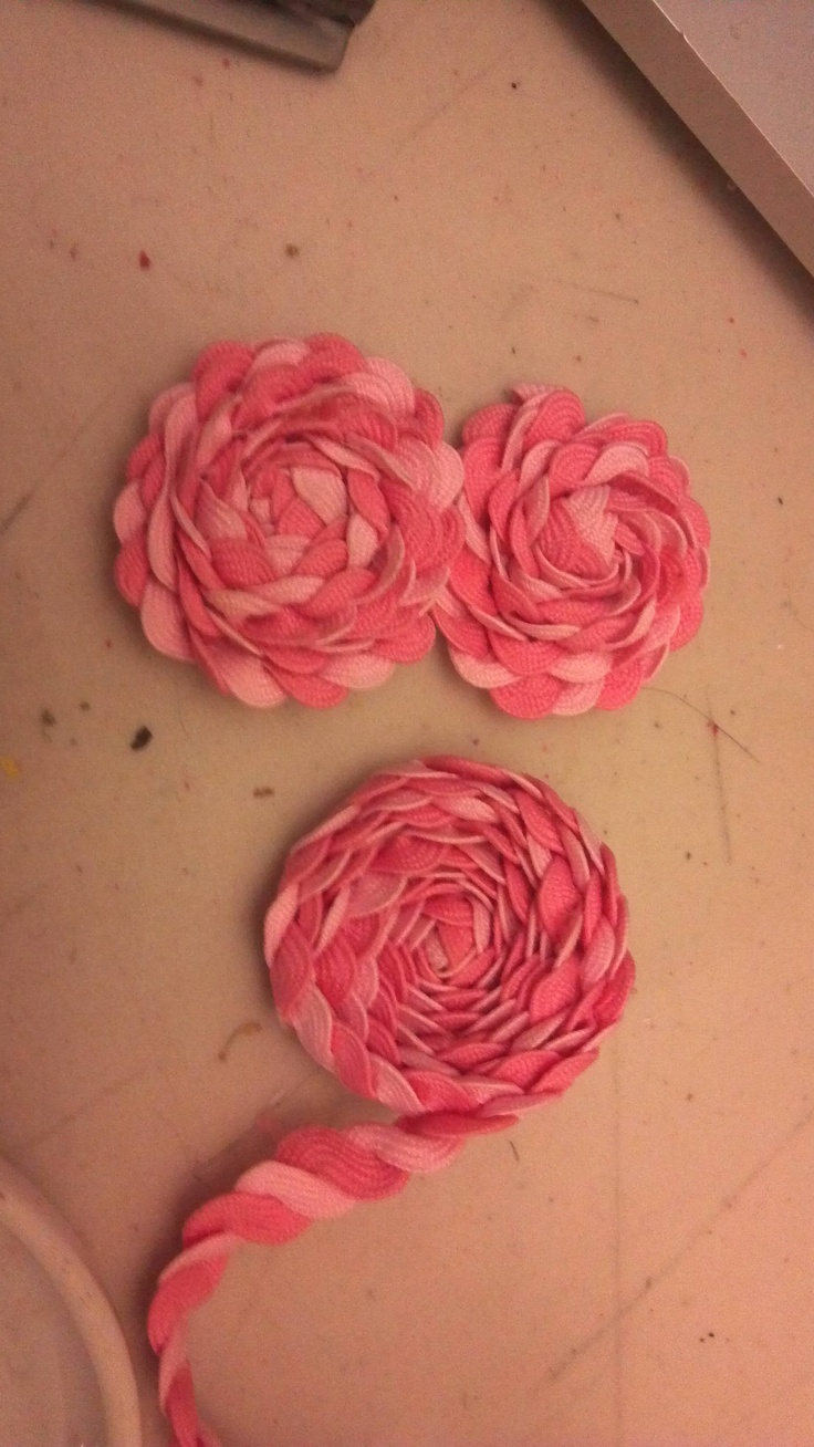 Ric rac flowers made today using tutorial floating around pinterest.  Used 2 different colors.