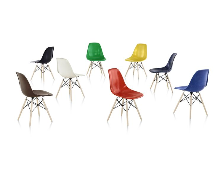 Eames molded fiberglass shell chairs with wood dowel base by Herman Miller; from…
