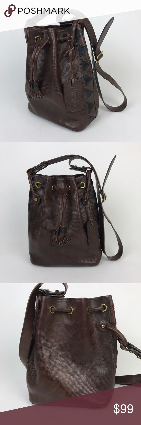 """[Vintage] Dooney & Bourke Aztec Bucket Bag Leather Rare vintage Dooney & Bourke bag. """"The Aztec"""" was a special edition limited production in the 1980s. Rich, brown textured thick Latigo cowhide. Large drawstring bucket bag. Vertical Southwestern designs on the sides. Leather luggage hang tag with Embossed logo.   🔹Dimensions: 9.5""""L x 5""""D x 12""""H 🔹Strap Drop: 21"""" 🔹Condition: Excellent vintage/pre-owned condition. Normal scuffs and surface scratches. Clean and no major signs of wear…"""