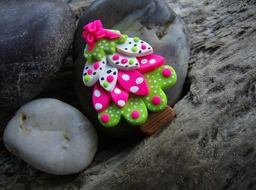 polymer clay. Looks kinda easy to do using basic flower petal shaped clay cutter and stack them up