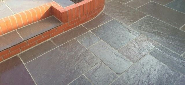 Natural Sandstone and feature walling. I love this paving, it looks smooth and effortless with natural earthy tones.