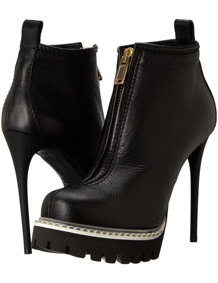 Let them know you mean business in the fierce McQ™ Cecile Zip Boot Round toe, platform ankle boots. Embossed leather upper. Pull on design with front zip closure. Back quarter pull tab for easy wear. Soft leather lining. Padded leather insole. Wrapped heel. Textured, synthetic sole. Made in Italy.