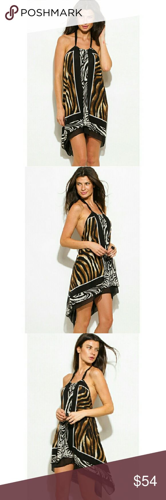 Animal Print Mini Dress This lightweight Handkerchief style Animal Print Mini Dress, features an open back, flowing design with a relaxed fit. Lined.Made of 100% Polyester.  Available in Small Medium Large  Please allow up to 7 business days for processing. Brand New With Tags!  Free Gift With Purchase! BOUTIQUE Dresses Mini