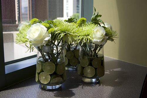Green and White centerpieces with limes