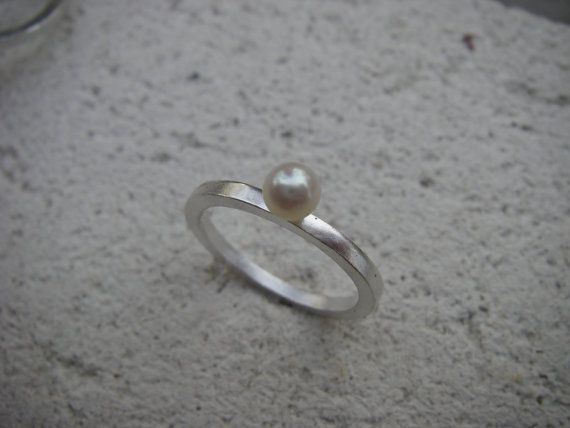 This June birthstone Pearl Lost & Found Stacking Ring features a pretty little pearl that was rescued from a gold earring that was melted down for the metal.