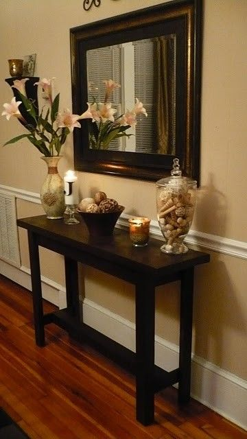 Something like this would be great for the entry. A narrow wood table and mirror, with some flowers and other pretty accents... love it!