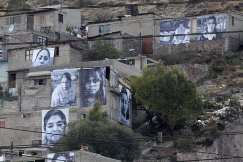 """""""When residents of Ecatepec, Mexico look to the hills, they now see the faces of crime victims staring back at them. Enormous photographic portraits cover concrete homes as part of a community art project that captures what has become a Mexican obsession: visualizing victimhood or, more broadly, turning cold, mind-numbing data back into real people.""""  http://www.nytimes.com/2012/03/22/world/americas/mexican-art-project-puts-faces-on-crimes-toll.html?_r=2"""