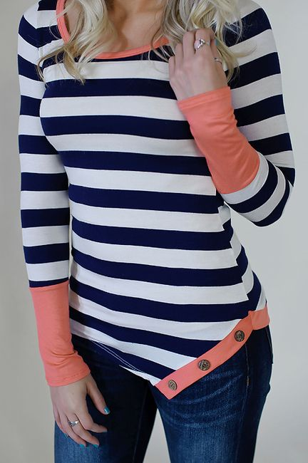Navy striped top with coral colorblock sleeves and colorblock and button hem detail.