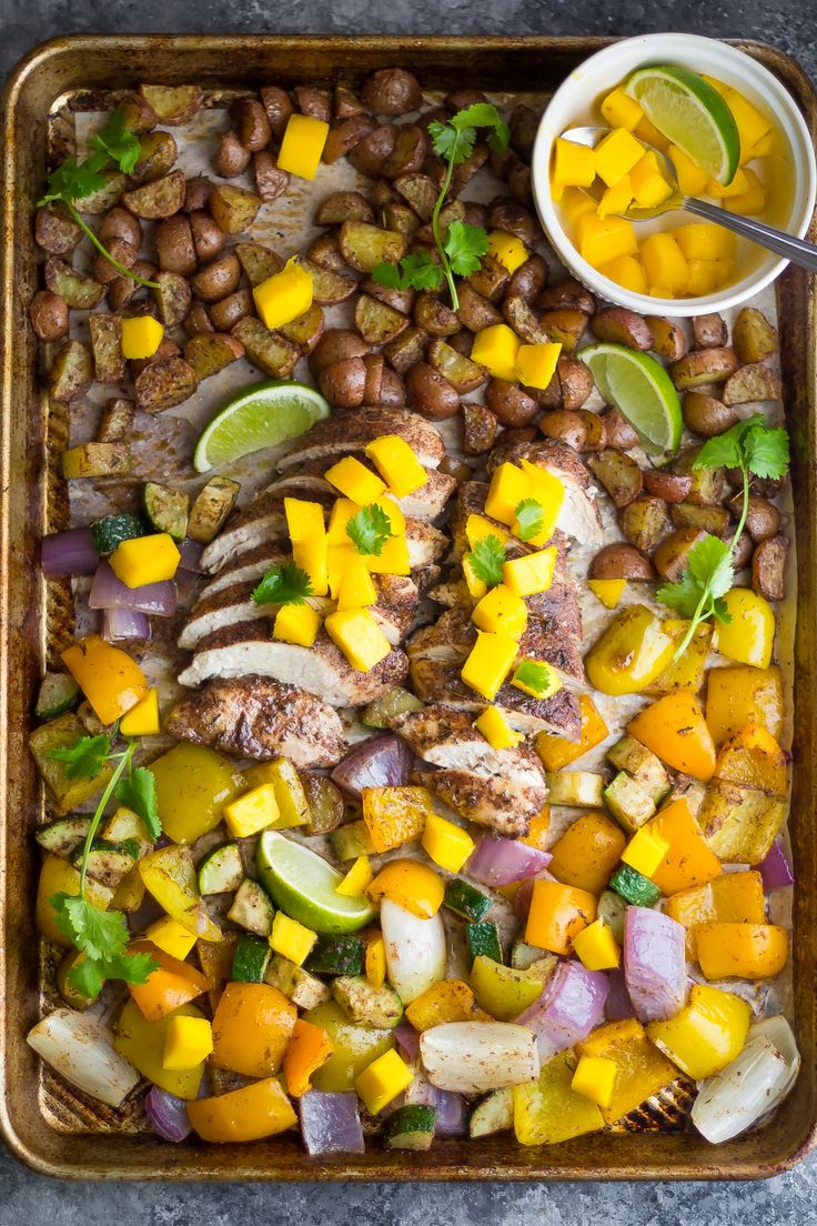 This healthy Jamaican chicken sheet pan dinner bakes up on one pan in under 30 minutes, making it perfect for an easy weeknight dinner.