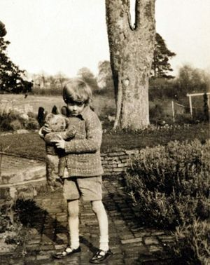 Christopher Robin with his stuffed bear ~ Christopher had a near idyllic childhood at the family's Cotchford Farm, and surrounding countryside, the 100 Acre Wood, the 6 Pine Trees, places near and dear to any fan of Winnie.