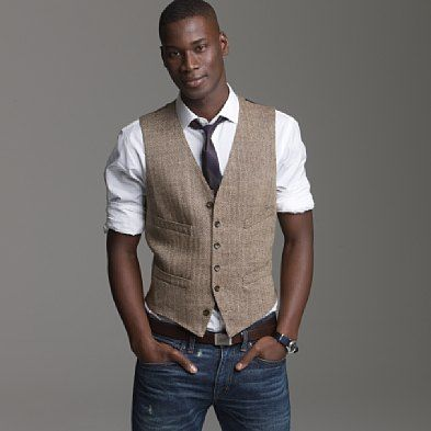 men's jeans with vest and leather belts rolled up long sleeved shirt and skinny tie for his sexy chic look