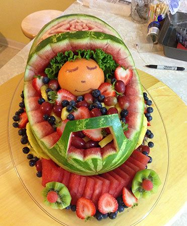 Watermelon baby carriage perfect for baby shower. See more fancy variations at http://www.vegetablefruitcarving.com/blog/watermelon-baby-carriage/