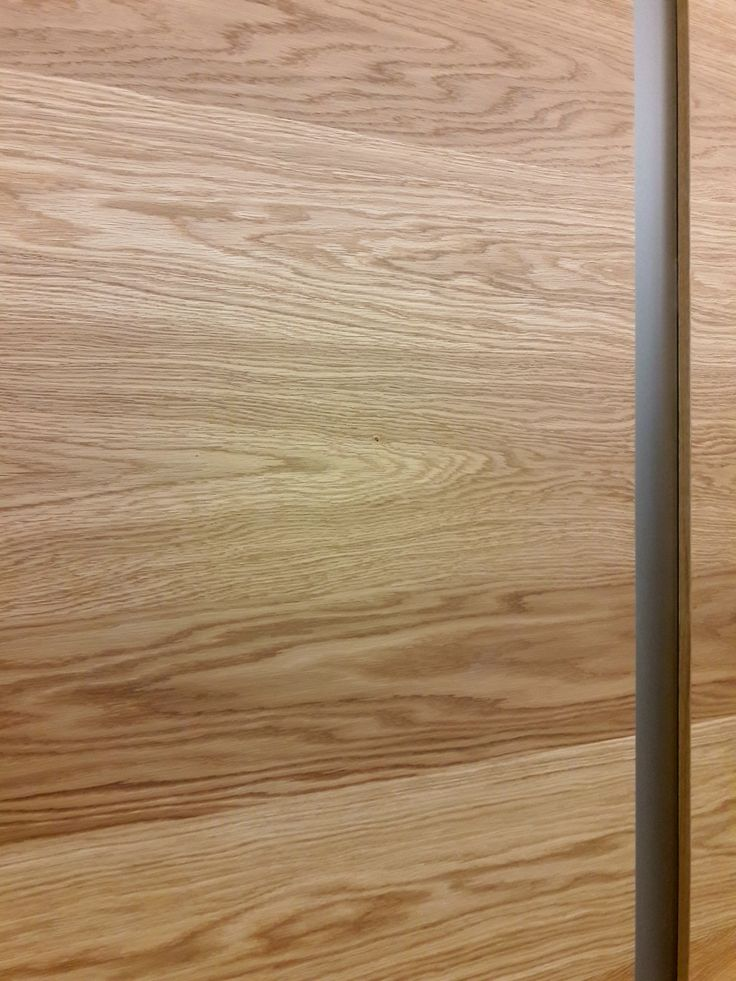 PRIMERA planked oak veneered doorpanel with narrow glass insert.