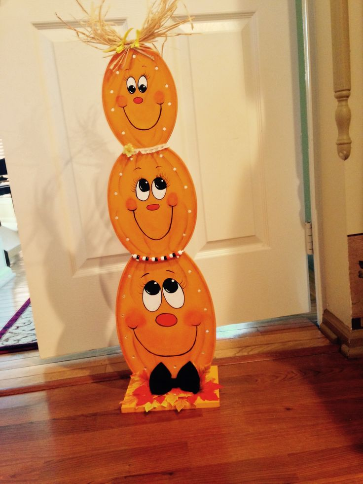 Halloween Stacking pumpkins. I purchased the wood piece from AC Moore. Painted it with acrylic paints. Used raffia for the hair. Strung beads for necklace and made a bow tie. Added lights later for extra glow.