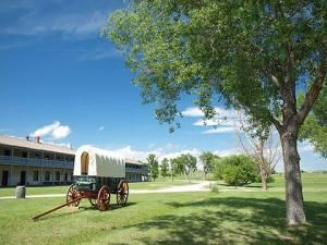 Wagon and restored cavalry barracks at Fort Laramie, Wyoming