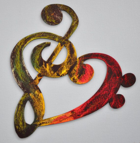 """I love this rastafarian inspired musical heart... it reminds me of our wedding invites which read """"With a song in our hearts..."""" :) You can purchase it here: http://www.etsy.com/listing/95570925/musicality-wooden-heart-rasta"""
