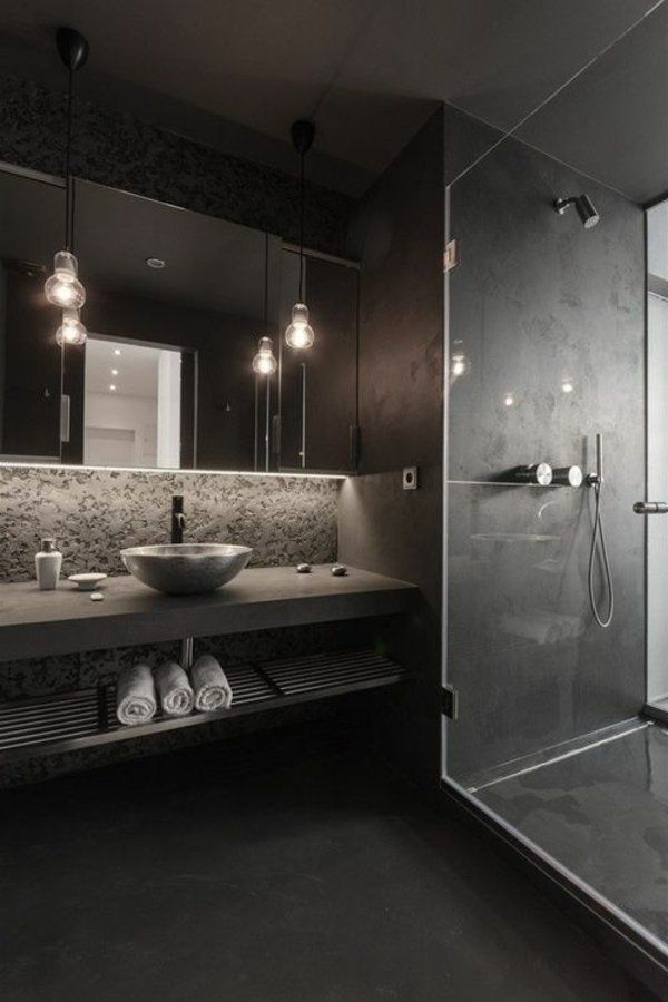en suite gray, small oval basin and suspended light bulbs