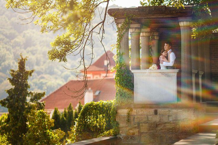 a couple from Hong Kong share a moment at Prague's Castle Garden www.KurtVinion.com