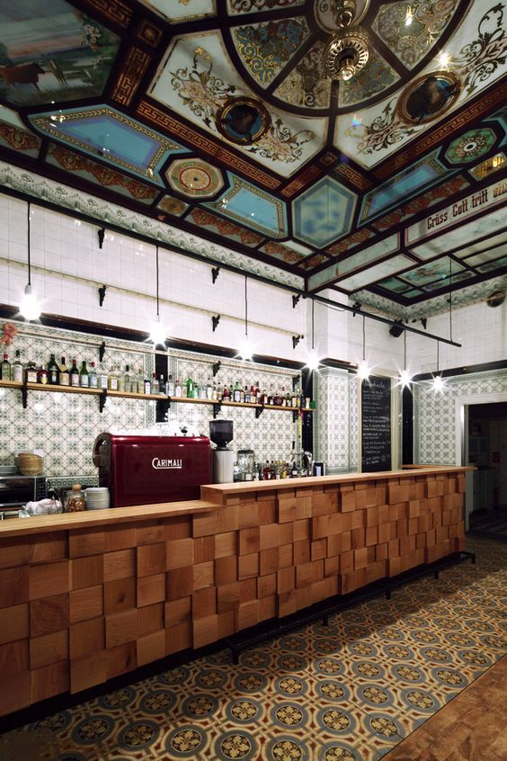 love the colorful tiles and the wood block tiles on the bar front Fleischerei Bar | Leipzig, Germany:
