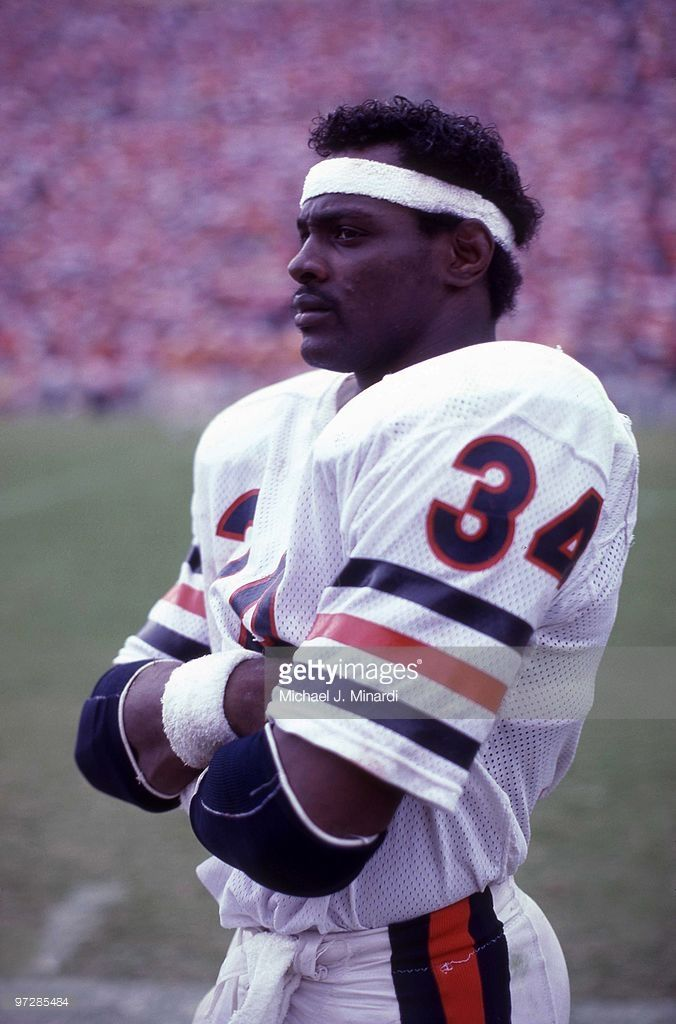 Running back Walter Payton #34 of the Chicago Bears looks on from th... Show more