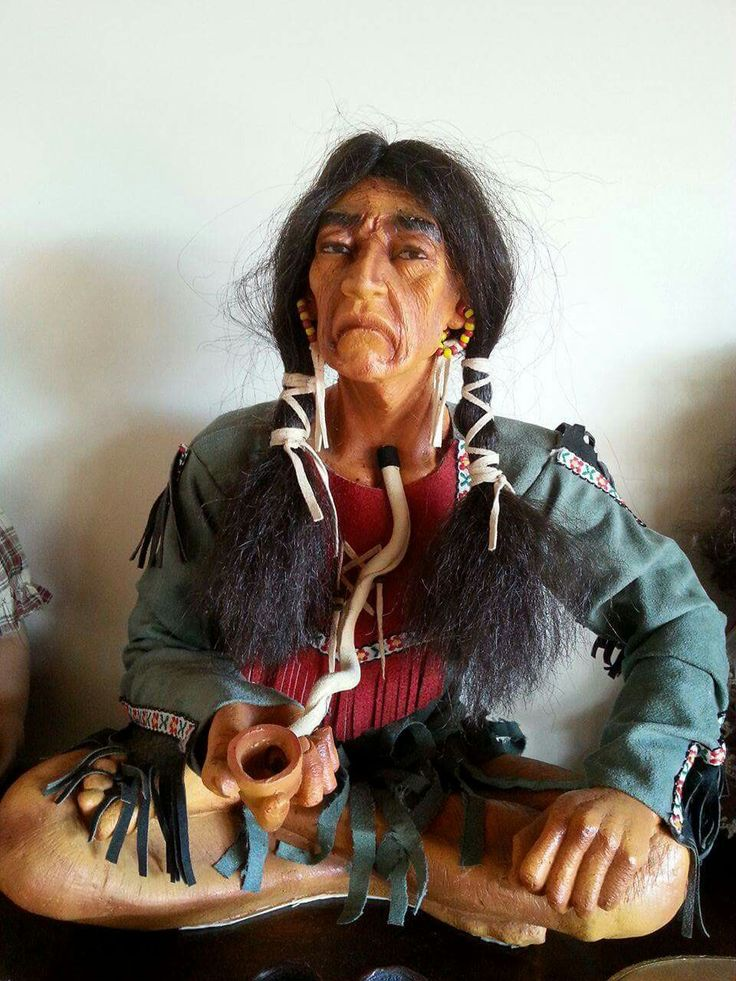 My unusual indian statue.....has real hair possibly horse hair and leather clothing and peace pipe.
